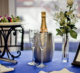 table set with champagne and strawberries
