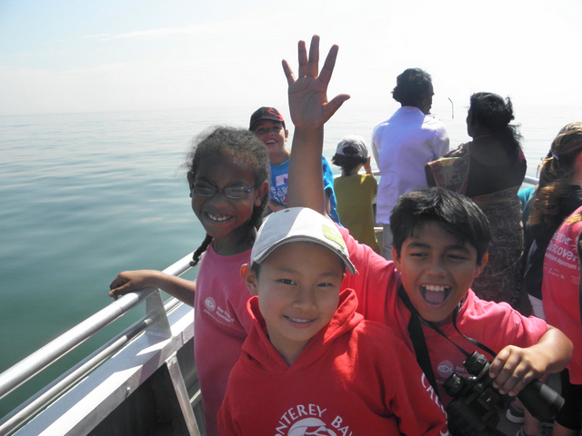kids wave on boat