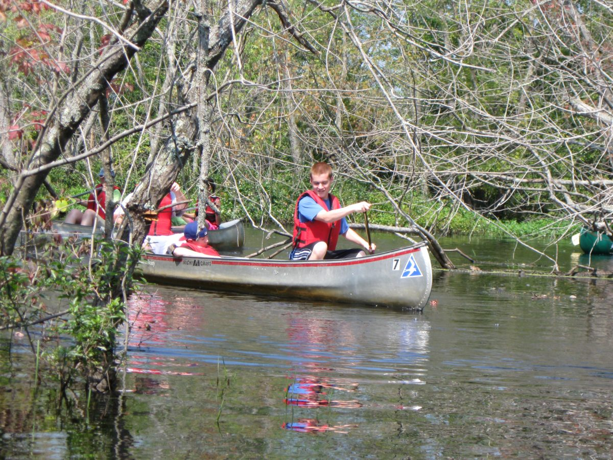 teens canoe through river