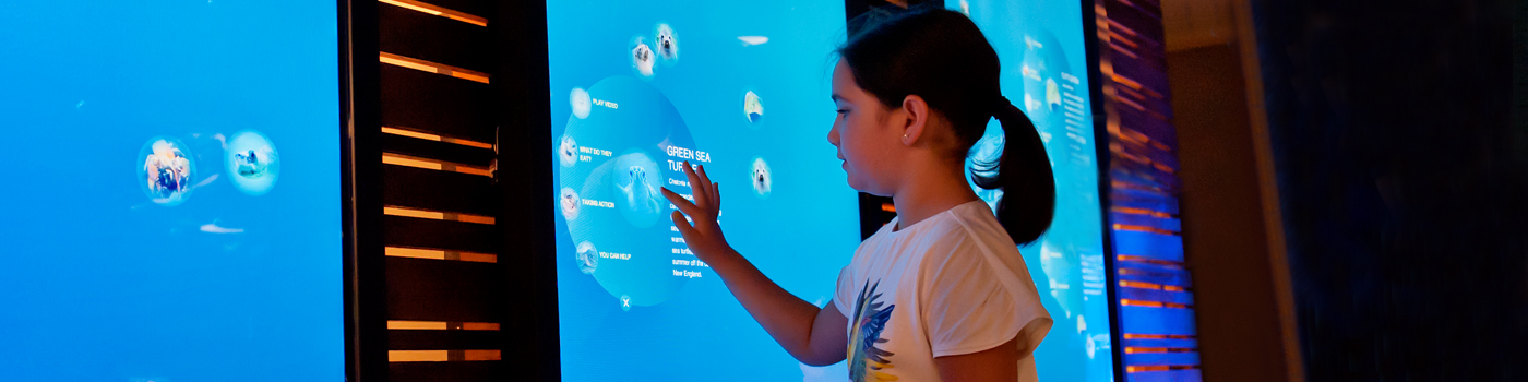 little girl learning in Blue Planet Action Center