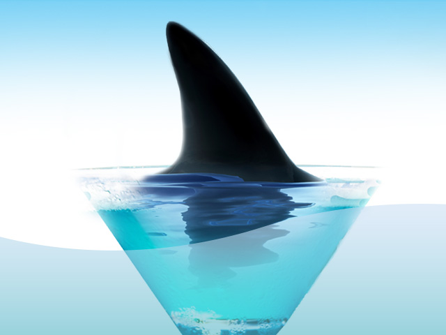 Image of a shark fin inside a martini glass