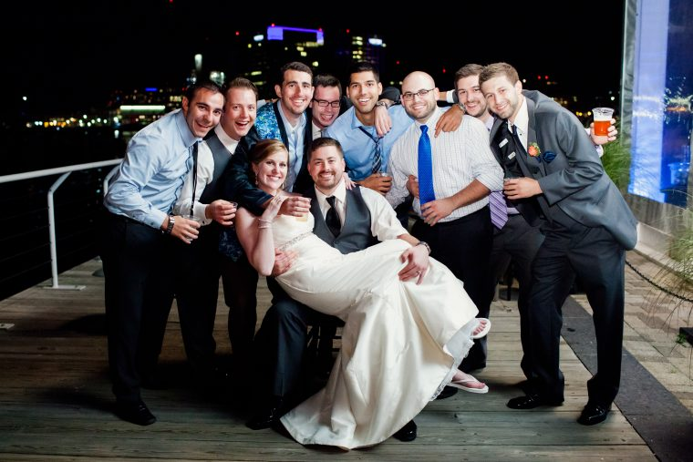 grooms party and bride picture outside venue