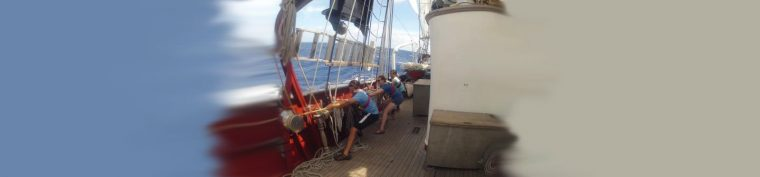 students pulling lines on sailboat