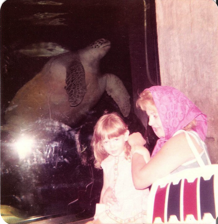 a visitor picture from 1973 with Myrtle through the glass