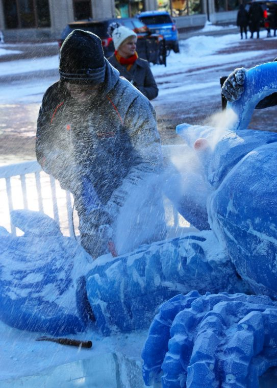 ice chips flying by ice sculptor