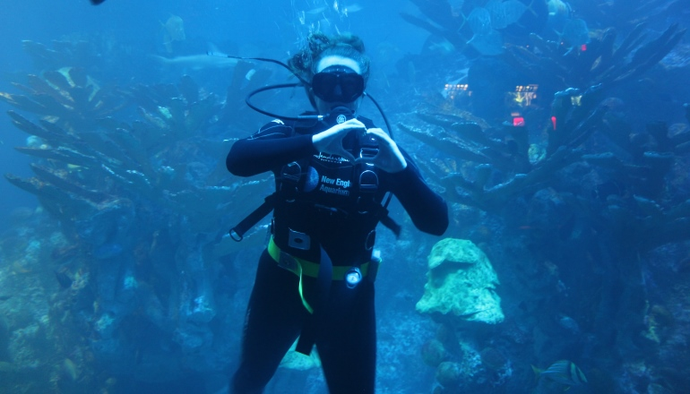 Diver making heart with hands in GOT tank