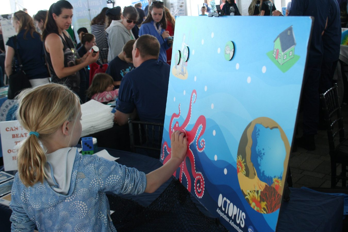Girl participating in octopus game at World Oceans Day 2017 in June