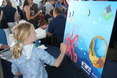 A visitor takes part in a hands-on activity at World Oceans Day 2017