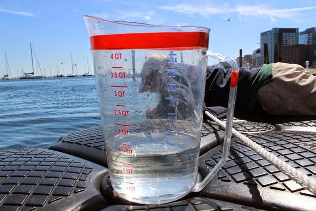 jug of water next to Boston Harbor