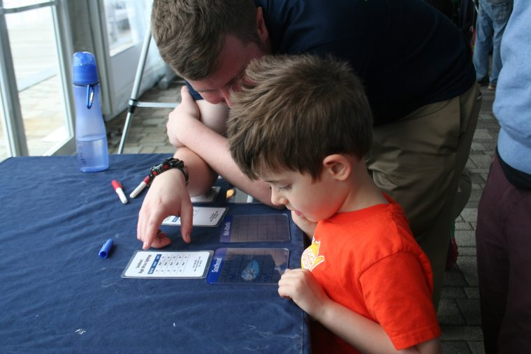 Visitors learn about right whales at the New England Right Whale Festival on May 6, 2018.