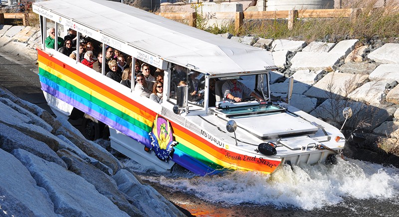 boston duck tour boat enters charles river