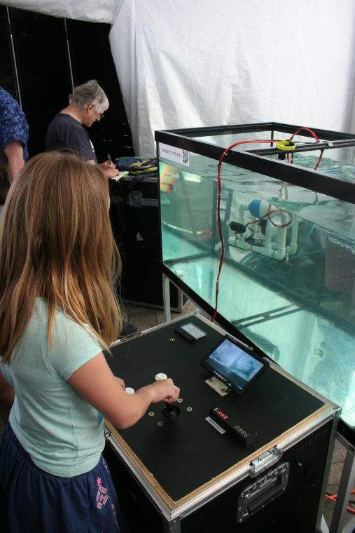 A World Oceans Day 2018 visitor operates a ROV.