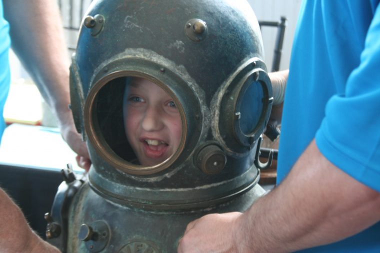 A World Oceans Day 2018 visitor models a diving helmet.