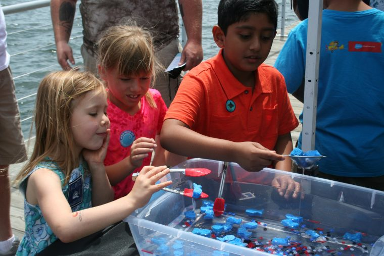 Kids learn about pollution in the oceans at World Oceans Day 2018.