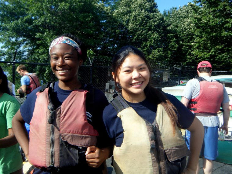 smiling teens in life vests