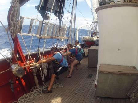 sailors pull rigging on boat