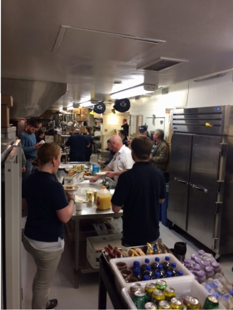 snow day staff get breakfast in the kitchen