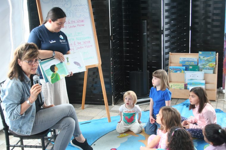 Children attend story time at the New England Right Whale Festival on May 6, 2018.