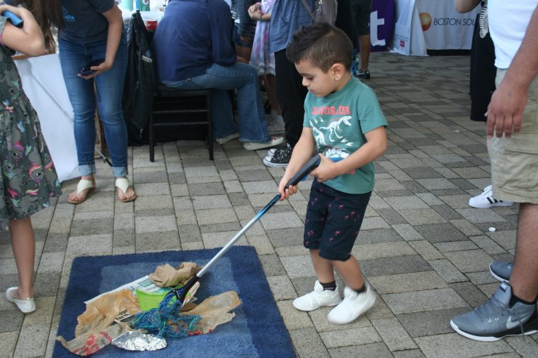 A World Oceans Day 2018 visitor participates in a cleanup activity.