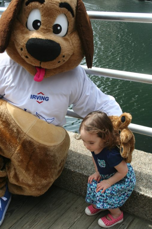 A World Oceans Day 2018 visitor poses with the Irving Oil mascot.