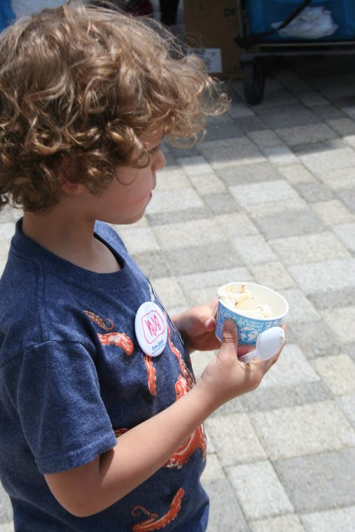 A World Oceans Day visitor samples a free cup of Ben & Jerry's ice cream.