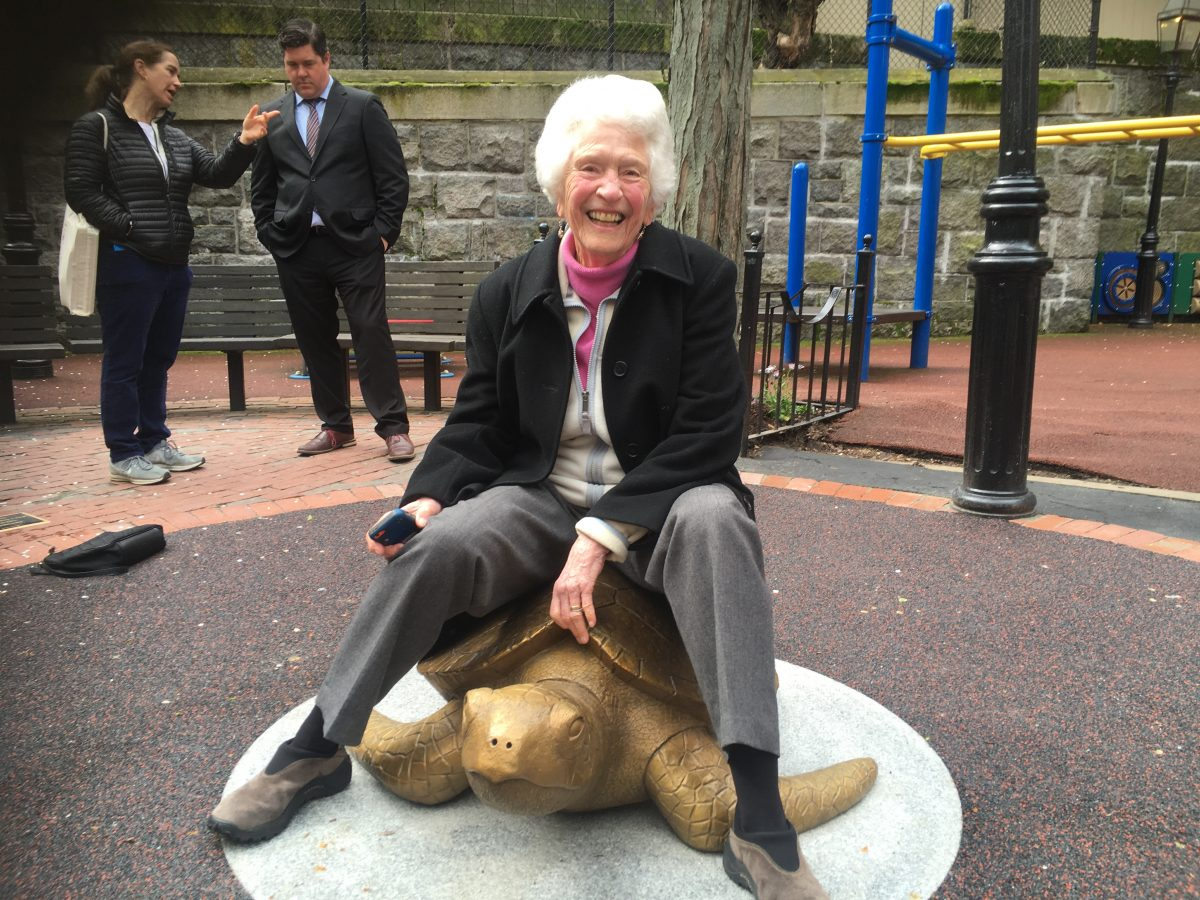 Nancy Schön hops on her newest sculpture, Myrtle the Sea Turtle!
