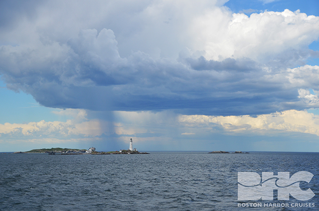 rain over island and lighthouse