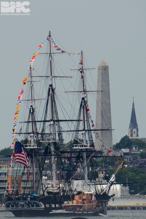 USS Constitution in front of Bunker Hill Monument