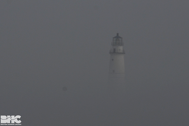 Fog envelopes Boston Light