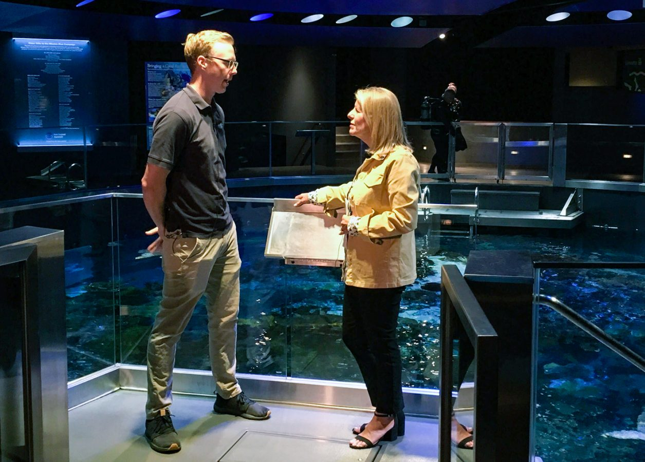 Mike O'Neill and Vikki Spruill talk at the top of the Giant Ocean Tank