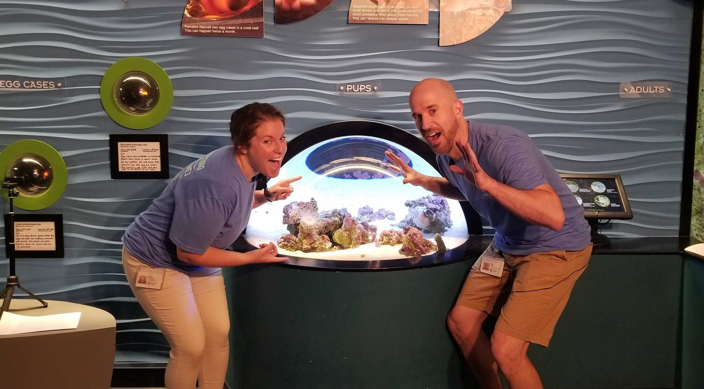 Aquarium educators Nick and Taylor in the Science of Sharks exhibit