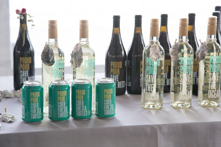 bottle and cans of Proud Pour products at the September 2019 Fin & Tonic event