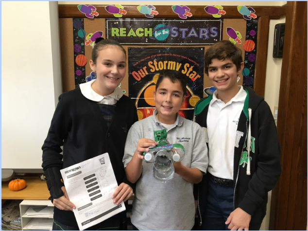 Sixth graders showing off their model of their Ocean Plastic Extractonator, which won 2nd place in the MA STEM Fair